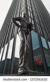 MONTREAL, CANADA - SEPTEMBER 3, 2018: Place darmes square with Edifice Banque Nationale building in the Old Montreal, a statue of a man with a long nose near the building. It is a landmark of Quebec