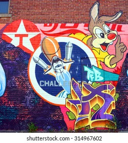 MONTREAL CANADA SEPTEMBER 4 2015: Street art rabbit and rocket. Montreal is the perfect place to walk in the back alleys and abandoned areas, looking for street art.