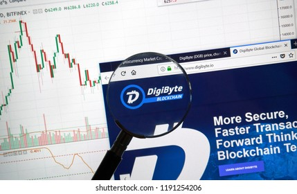 MONTREAL, CANADA - SEPTEMBER 8, 2018: DigiByte altcoin site under magnifying glass. Blockchain is a growing list of records which are linked using cryptography.