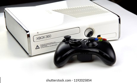 MONTREAL, CANADA - SEPTEMBER 8, 2018: Xbox 360 video gaming console with a controller on a table. The Xbox 360 is a home video game console developed by Microsoft.
