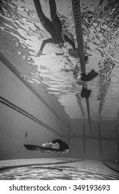 MONTREAL, CIRCA JUNE 2014 - Two Hot Spring Days of Freediving Competition at Jean-Drapeau 50m Outdoor Olympic Pool. Freediver Dynamic with Monofin Performance from Underwater
