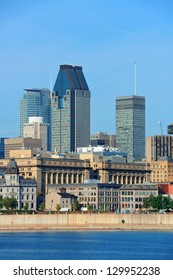 Montreal city skyline over river in the day with urban buildings