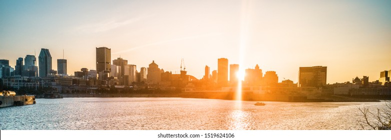 Montreal city skyline at sunset banner background view of downtown from old port, harbourfront panorama. Summer travel destination, Canada, North America.
