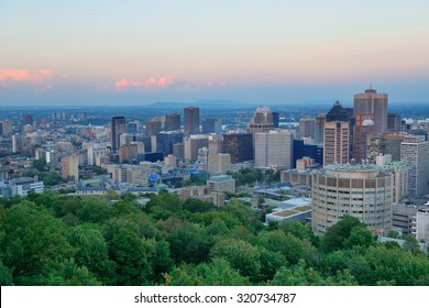 Montreal city skyline at sunset viewed from Mont Royal with urban skyscrapers.