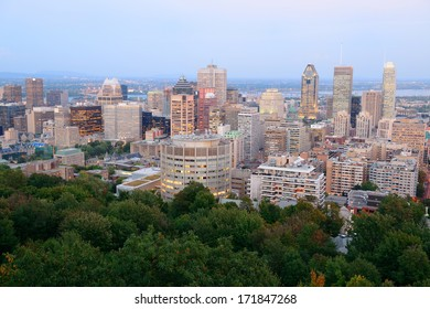Montreal at dusk with urban skyscrapers viewed from Mont Royal