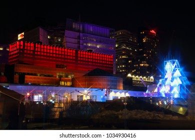 Montreal Festival of Lights. Colorful illuminated silhouettes in the night. lighting installations. Winter festival of arts. Outdoor family activities. Entertainment District.
