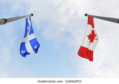 MONTREAL - JULY 1: Quebec and Canada National flags are flying on national day of Canada, on July 1, 2009 in Montreal, Quebec, Canada.