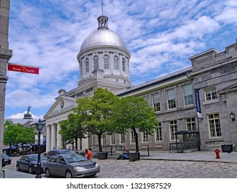 MONTREAL - JUNE 2013:  The old port area of downtown Montreal has preserved historic architecture dating back to the 1700s, and has quaint shops and restaurants.
