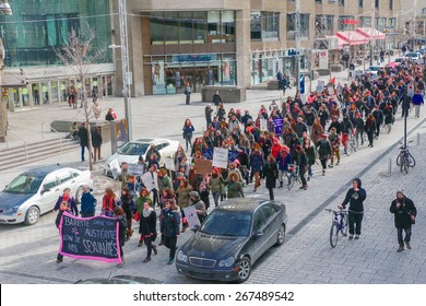 MONTREAL - MARCH 29: A procession fills a street in Montreal during a rally in Montreal organized by women's rights groups who oppose Quebec's Bill 20, which would limit access to abortions.