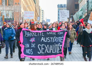 MONTREAL - MARCH 29: A procession fills a street in Montreal during a rally organized by women's rights groups who oppose Quebec's Bill 20, which would limit access to abortions.