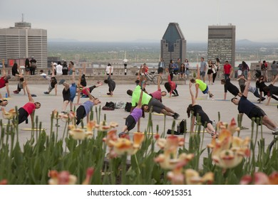 MONTREAL - MAY 26, 2016: People excersizing on top of Mont Royale, which overlooks the city of Montreal, Quebec.