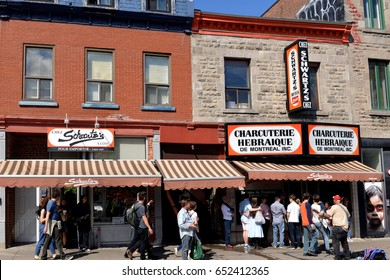 MONTREAL - MAY 27, 2017: People line up outside Schwartz's, aka the Montreal Hebrew Delicatessen, the famous  Montreal style smoked-meat restaurant.  It is owned by a group that includes Celine Dion.