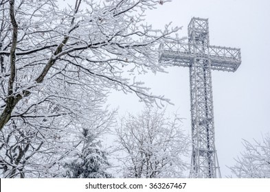 Montreal Mont-Royal Cross during snow storm, in Winter.