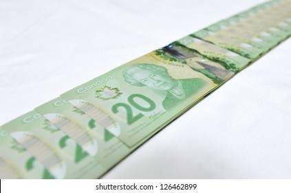MONTREAL - NOVEMBER 19: The new polymer twenty dollar bill, which is the most widely used bank note in the country, is pictured on November 19, 2012 in Montreal, Quebec, Canada.