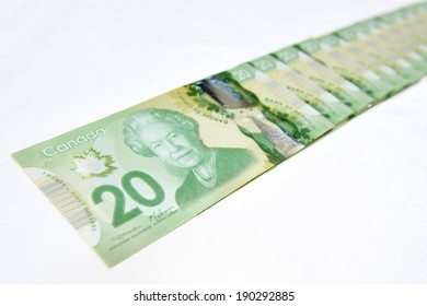 MONTREAL - NOVEMBER 19: Some Canadian twenty dollar bills, which is the most widely used bank note in the country, are photographed on November 19, 2012 in Montreal, Quebec, Canada.
