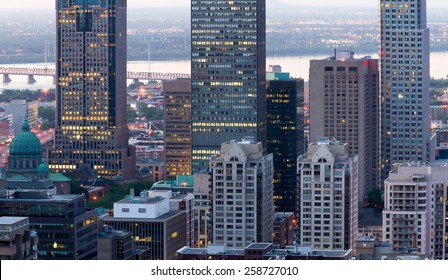 Montreal office buildings, and the church to the left of the image with a little digital noise at dusk.