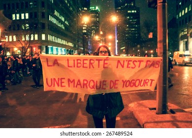 MONTREAL - Over 50,000 students are on strike in Quebec. A young woman holds up a hand-painted sign during a protest in Montreal.