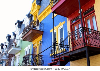 Montreal, QC / Canada - April 11 2019: beautiful colorful painted houses on the Plateau Mont Royal, hipster neighborhood affected by gentrification and airbnb so expensive for rent and house purchase.
