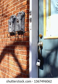Montreal, QC / Canada - April 11 2019: a door of a red brick house in the trendy heighborhood of Plateau Mont Royal, a hip residential area of city center infested with AirBnB short term rentals.