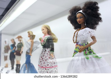 Montreal, QC / Canada - April 7 2019: collectible Barbie dolls by Mattel in national costumes and fantasy dresses in Barbie Expo, a doll exhibition in Cours Mont Royal in downtown.