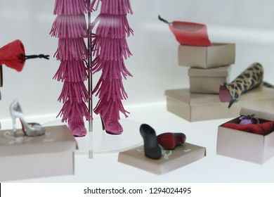 Montreal, QC / Canada - January 23 2019: a collection of Barbie shoes at Barbie Expo at Les Cours Mont Royal. Louboutin Barbie has many extra shoes with signature red soles.