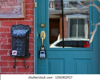 Montreal, QC / Canada - March 25 2019: the key lock box is installed outside Plateau Mont Royal apartment, one of many. Airbnb infestation of trendy neighborhoods leads to evictions and less rentals.
