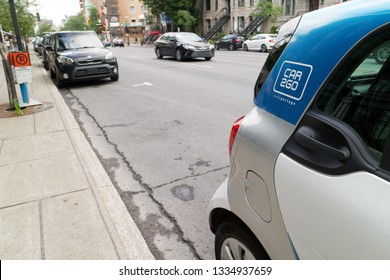 MONTREAL QC/CANADA 22 JULY 2018 A Car2Go car sharing Smart car parked on Rue Sherbrooke in Montreal
