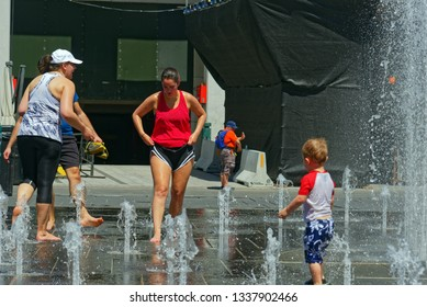 MONTREAL QC/CANADA JULY 21 2018 People keeping cool in the water fountains in Montreal in the 2018 heatwave