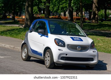 MONTREAL QC/CANADA JULY 21 2018 A Car2Go carsharing vehicle parked in Montreal