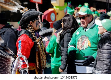 MONTREAL QC/CANADA MARCH 18 2018 An Amerindian in full Mohawk costume at Montreal St Patrick's Day Parade