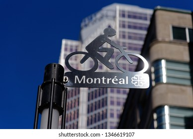 MONTREAL QC/CANADA MARCH 18 2018 Sign for the Claire Morissette cycle path on Maisonneuve street in downtown Montreal, Quebec, Canada