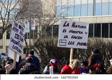 Montreal, QC/Canada - March 8, 2020: Crowd holding flags and signs during Woman Demonstration in Montreal on International Woman's Day.