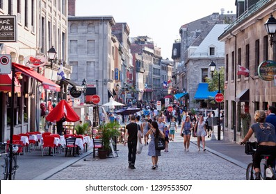 Montreal, Quebec, August 21, 2017 - Horizontal view of the cobbled streets, filled with tourists, in Old Montreal