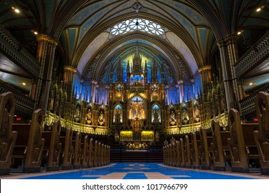 Montreal, Quebec / Canada - 03/17/2015: The beautiful interior nave of the  Notre Dame Cathedral in Montreal, Canada with no visitors around