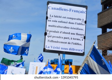 MONTREAL QUEBEC CANADA 05 04 19: Sign of hundreds of supporters of the bill, 21 which would ban some government workers from wearing religious symbols, assembled outside of the TVA television