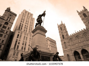 MONTREAL QUEBEC CANADA 05 17 12: Statue of Paul de Chomedey, sieur de Maisonneuve first governor of Montreal. in front the Notre-Dame Basilica is a basilica in the historic district of Old Montreal