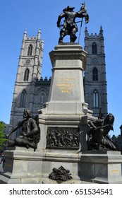 MONTREAL QUEBEC CANADA 05 17 17: Statue of Paul de Chomedey, sieur de Maisonneuve first governor of Montreal. in fromt the Notre-Dame Basilica is a basilica in the historic district of Old Montreal