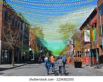 "MONTREAL QUEBEC CANADA 06 12 17: Colofull Rainbow balls art installation ""18 shades of gay"" on Saint-Catherine Street in gay Village  balls decorating Le Village gai or the Village gay neighborhood"