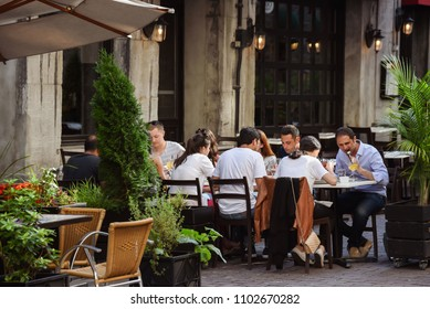 Montreal, Quebec /Canada - 07-17-2018: group of young adults dining outside at sidewalk cafe in summertime