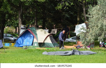 MONTREAL QUEBEC CANADA 09 12 2020: Residents of Montreal homeless shelters. A group of about 50 people who have been living in tents along Montreal's Notre-Dame Street are refusing to leave
