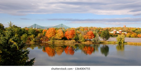 MONTREAL QUEBEC CANADA 10 2010: Fall landscape from Parc Jean Drapeau with the Jacques Cartier bridge in background