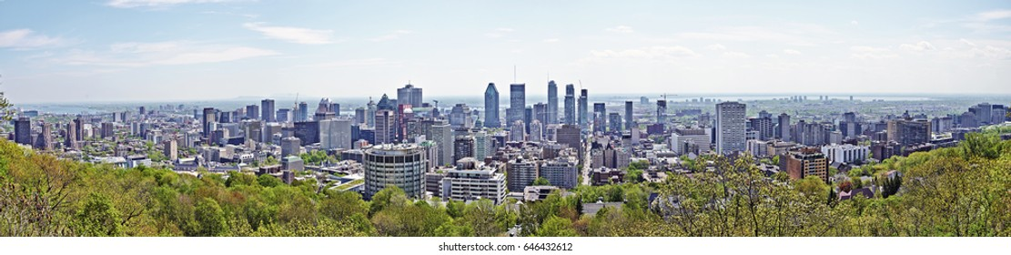 MONTREAL, QUEBEC, CANADA - 18 MAY 2017: Skyline Panorama of the city of Montreal, Quebec, Canada. Shot from the Mount Royal above the city.