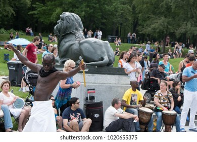 Montreal, Quebec, Canada - 2 July 2017: Black man dancing to music produced in the famous drum circle Tam Tams at the base of Mont Royal in Parc du Mont Royal, Montreal.