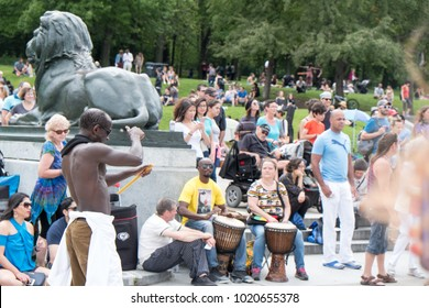 Montreal, Quebec, Canada - 2 July 2017: Black man dances to music produced in the famous drum circle Tam Tams at the base of Mont Royal in Parc du Mont Royal, Montreal on a hot summer day.