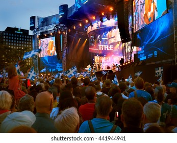 Montreal Quebec Canada  23 June 2016  Brigitte Boisjoli All Stars National St John Baptist Day celebration concert. Audience crowd downtown waving flags with pride  for their Quebecois musicians