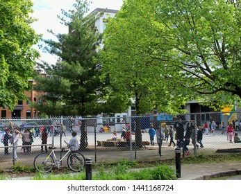 Montreal, Quebec / Canada - 4 June 2019: children play in the school yard on Plateau Mont Royal, a residential neighborhood in city center.