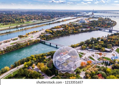 Montreal, Quebec, Canada, aerial view of Biosphere Environment Museum and Saint Lawrence river during fall season.