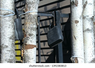 Montreal, Quebec / Canada - April 11 2019: lock boxes of Air BnB on the Plateau Mont Royal attached to the gate decorated by birch tree trunks. The problem of short term rentals is important in area.