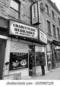Montreal, Quebec, Canada: April 13, 2018: A black and white photo of the outside store front of Schwartz's Deli in Montreal, Canada.  Schwartz's Deli is a famous Canadian eatery landmark.