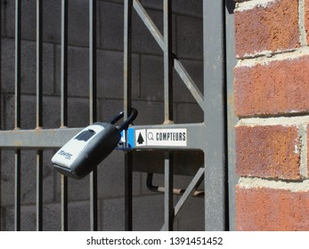 Montreal, Quebec / Canada - April 22 2019: a lock box of an AirBnB short term rent apartment in a trendy neighborhood Mile End, already suffering from gentrification and lack of long term rentals.